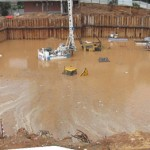 Work site inundation, danger of collapse to surrounding buildings